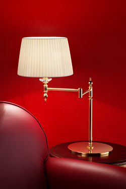 Golden articulated table lamp. Masiero.