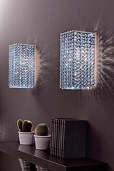 Aurea long wall lamp in cut crystal and chromed metal. Masiero.