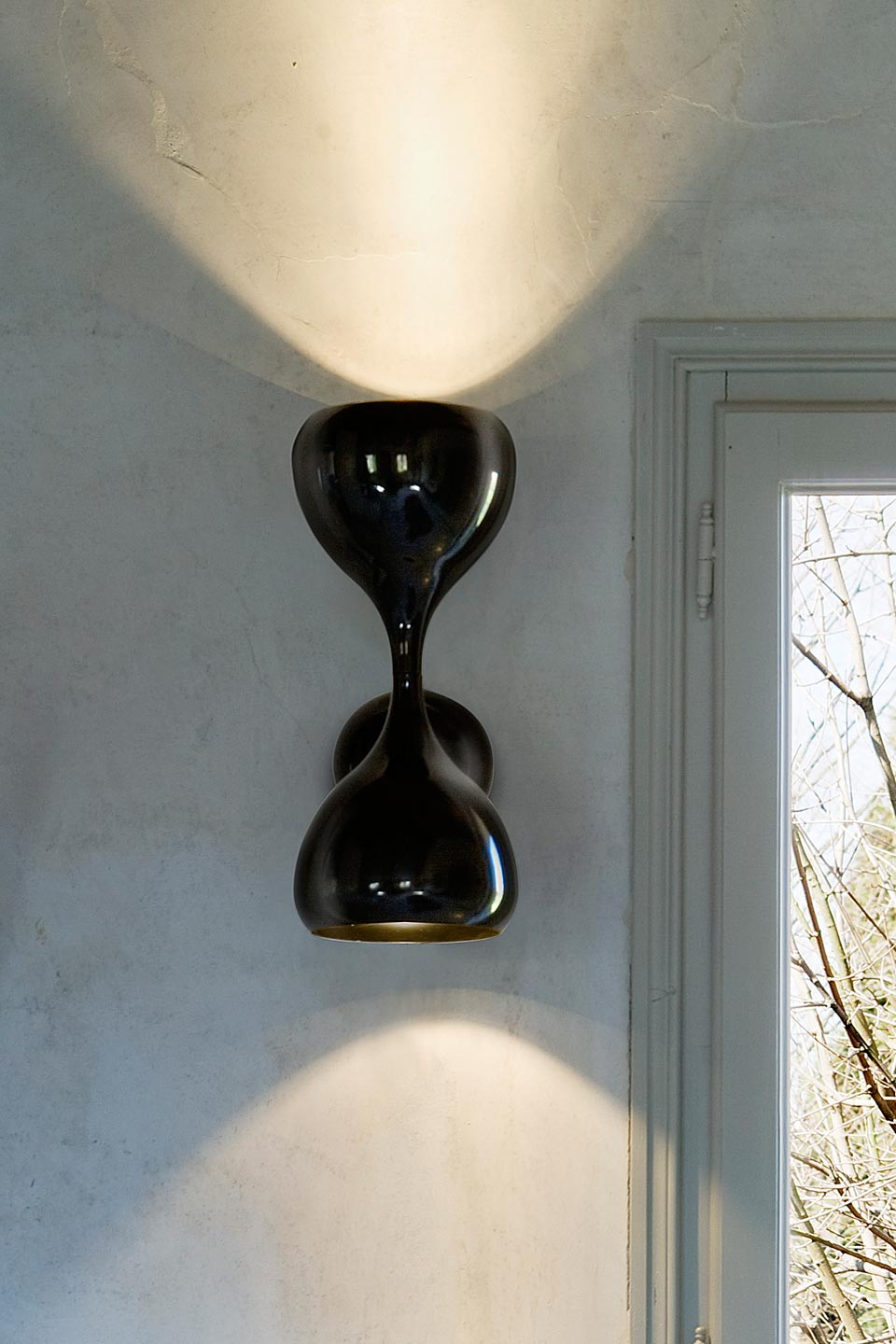Black Blob wall lamp in lacquered metal. Masiero.