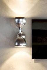 Blob wall lamp in metal decorated with silver leaf. Masiero.