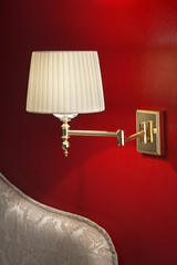 Golden articulated wall light. Masiero.