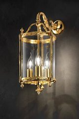 3-light golden lantern sconce. Masiero.