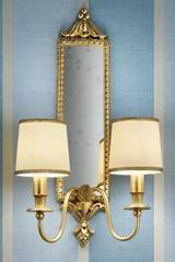 Leaf motif double gold-plated bronze wall light with mirror and beige silk shades. Masiero.