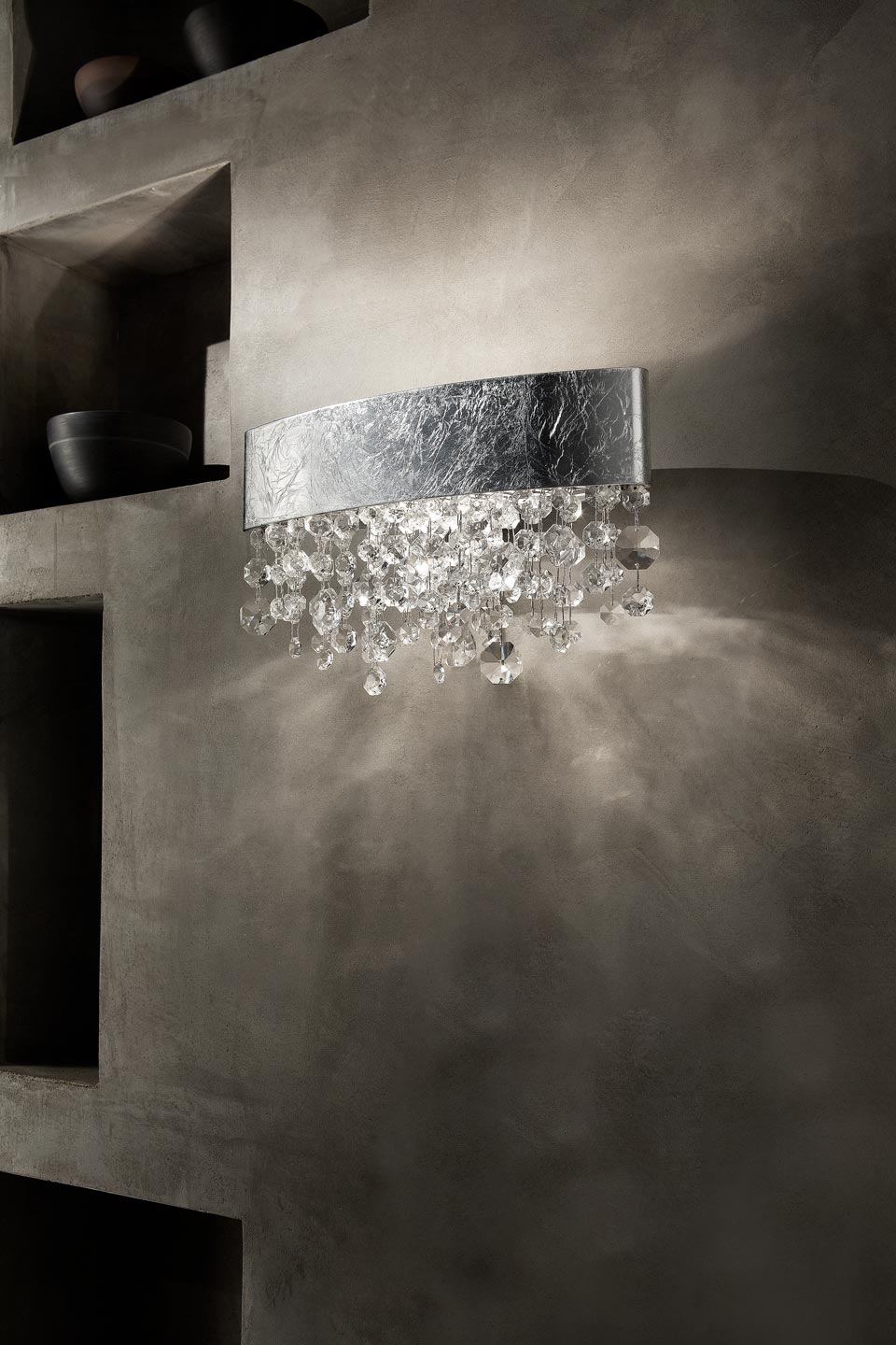 Ola wall lamp in silver painted metal with silver leaf. Masiero.