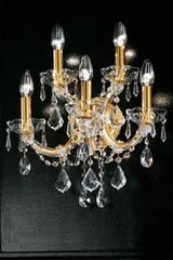 Single-scrolled 5-light crystal and gold-plated-metal wall light . Masiero.