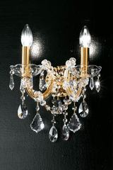 Twin wall light in clear crystal with gold-plated-metal scrolled arms. Masiero.