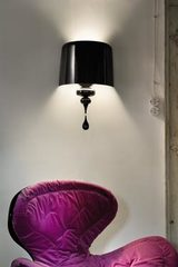 Very large Eva wall lamp in black lacquered resin and polyurethane. Masiero.