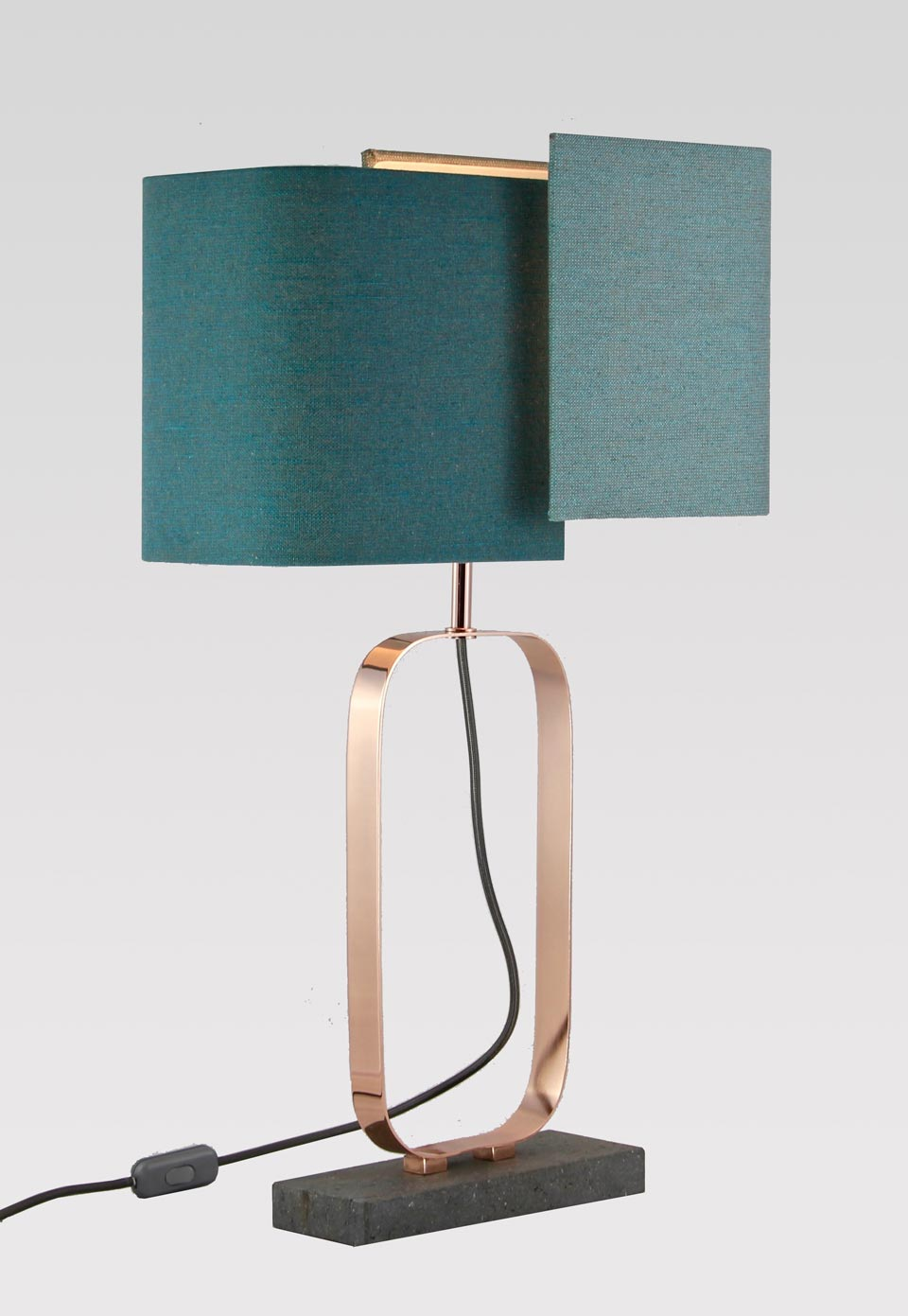 Cubic grey marble and bright copper metal lamp. Matlight.