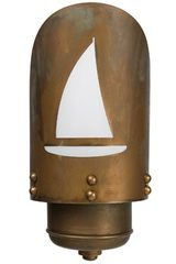 Exterior wall light in aged brass with laser cut boat. Moretti Luce.