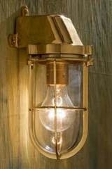 Admiral wall light in polished bronze with clear glass. Nautic by Tekna.