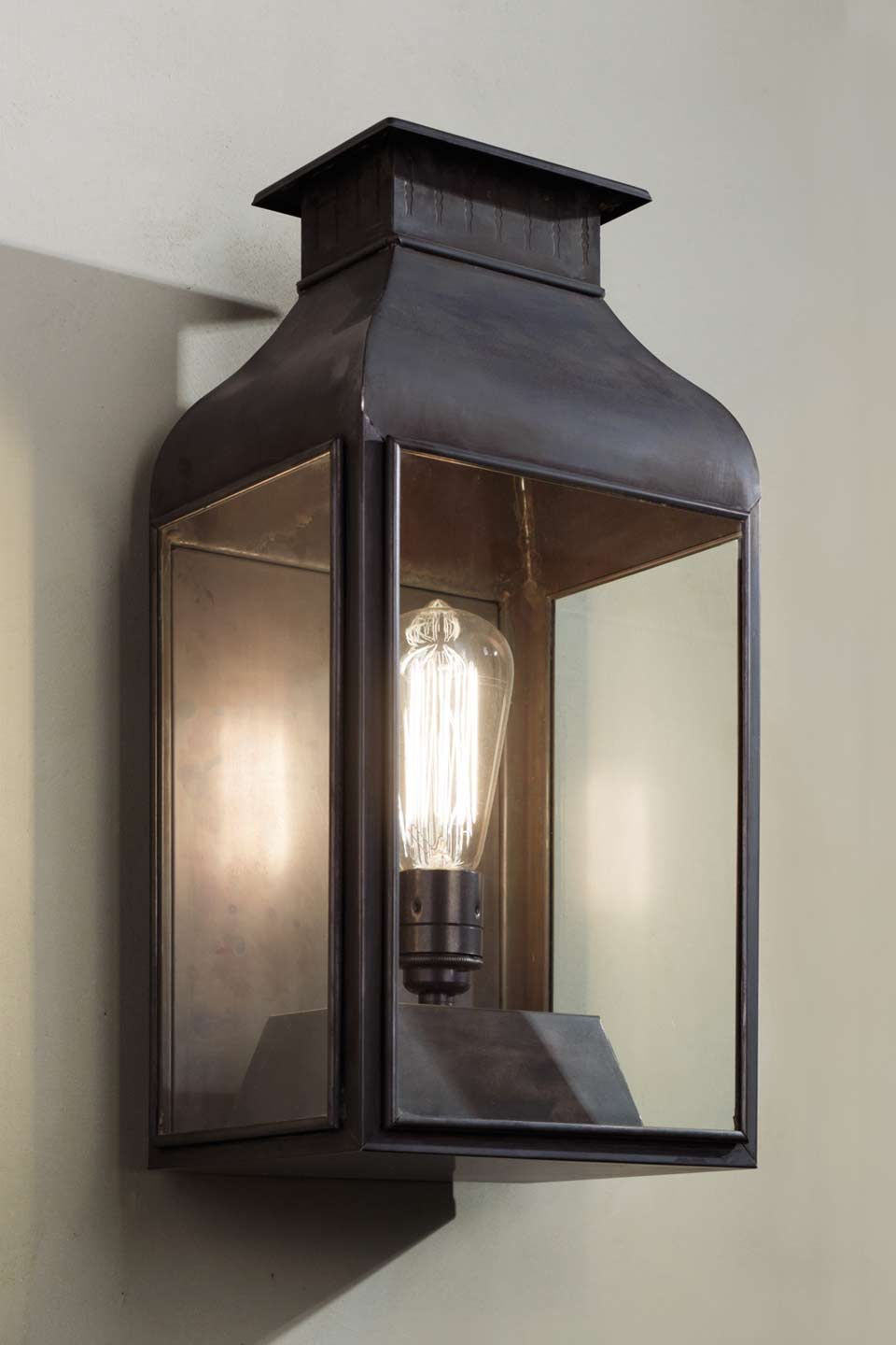 Wall Light In Antique Bronze With Clear Gl