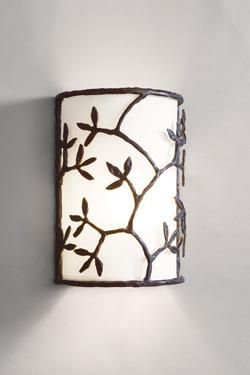 Applique demi-cylindre motif branches et feuilles en bronze. Objet insolite.