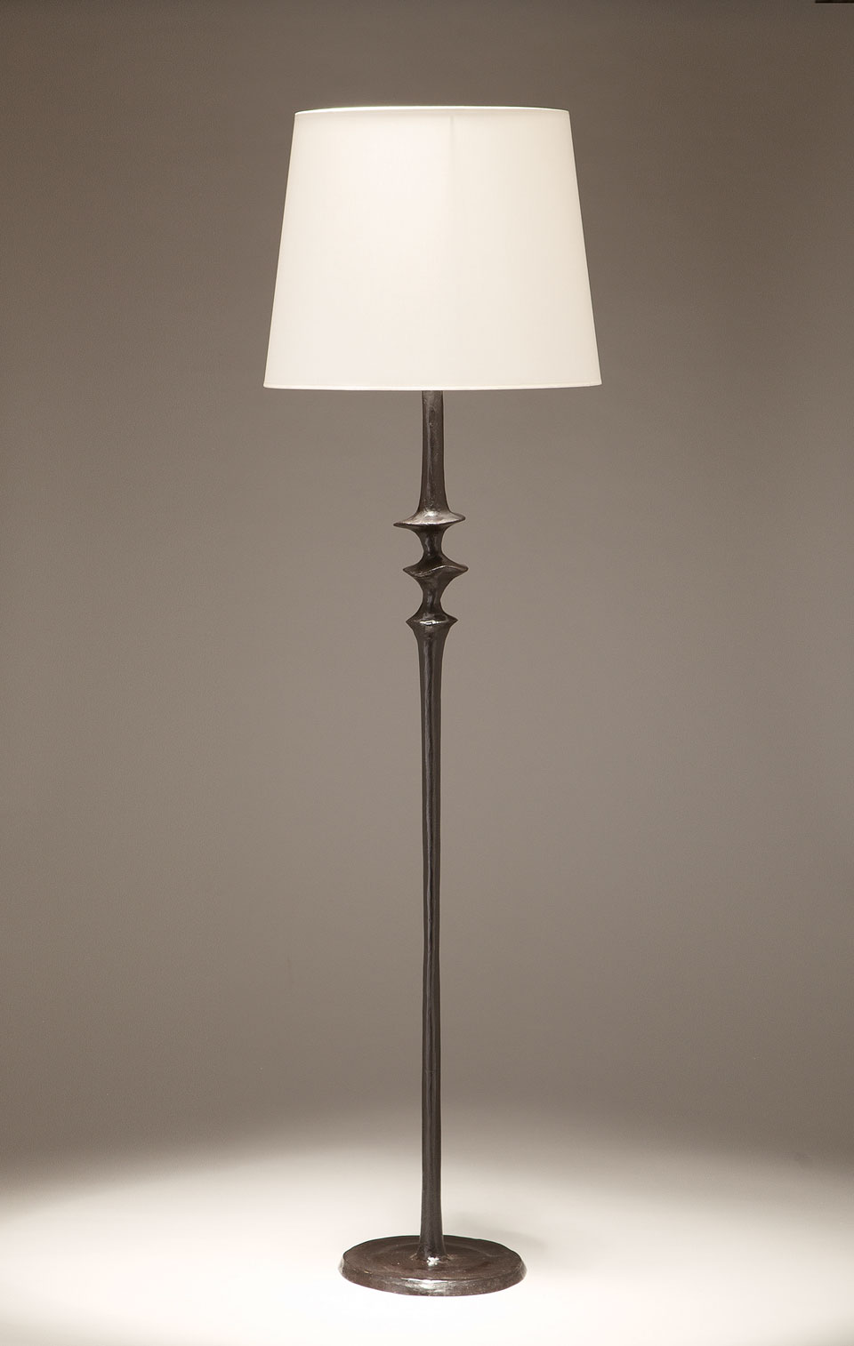 Floor lamp Mancha patinated black solid bronze foot . Objet insolite.
