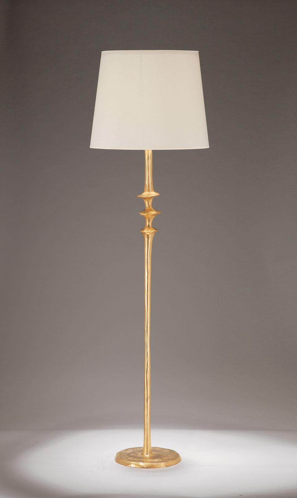 Lampadaire pied en bronze massif doré Mancha. Objet insolite.