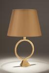 Lampe de table en bronze doré pied avec un large anneau Sonia. Objet insolite.