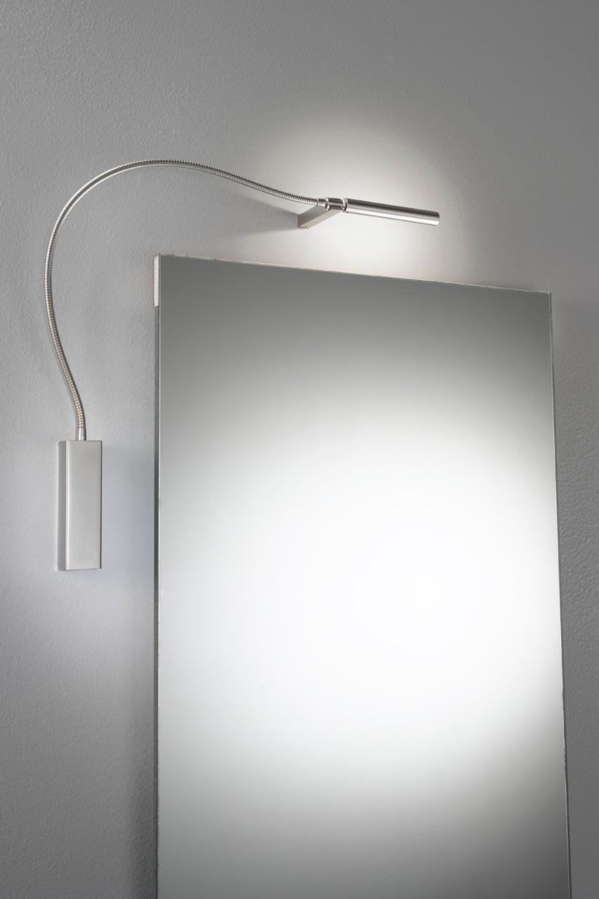 Applique pour miroir ou tableau sur flexible nickel satiné. Oma Illuminazione.