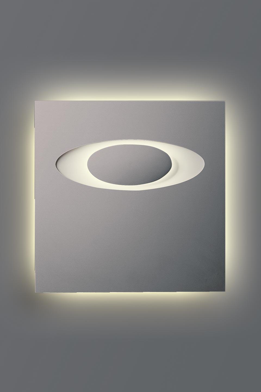 Applique Eclipse 1594 en plâtre naturel blanc motif en ellipse. Sedap.