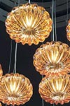 Diamante suspension en cristal de Murano ambre à cinq globes. Vistosi.