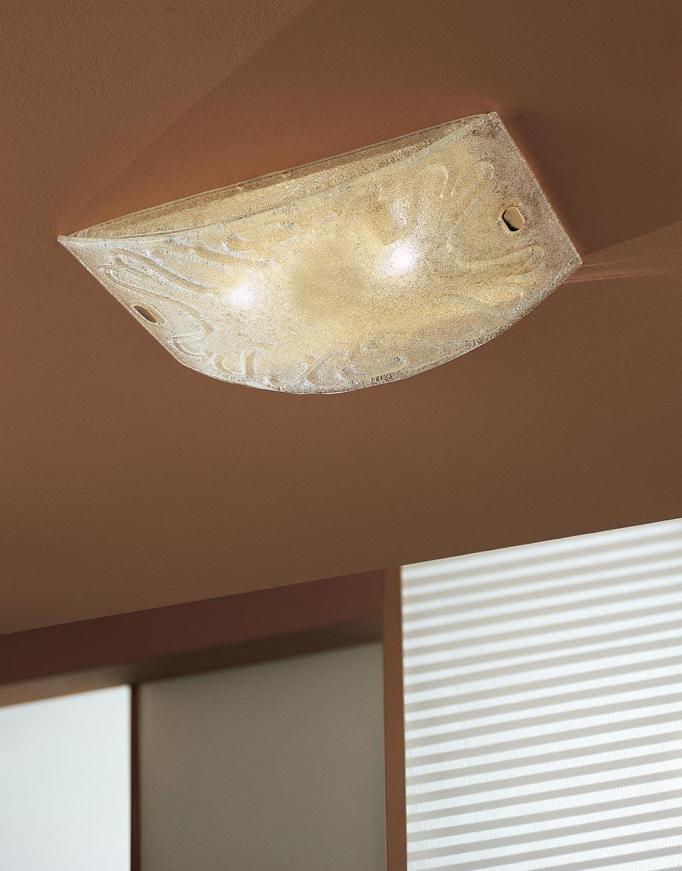 Plafonnier Dogi en cristal de Murano transparent et acier doré. Vistosi.