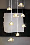 Suspension huit globes aplatis en verre ambre Ninfea. Vistosi.
