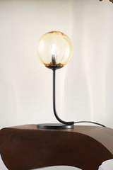 Black and amber table lamp Puppet. Vistosi.