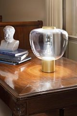 Reflex table lamp transparent glass and satin brass. Vistosi.