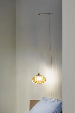 Diamante bedside wall lamp on bracket in amber solid Murano glass. Vistosi.